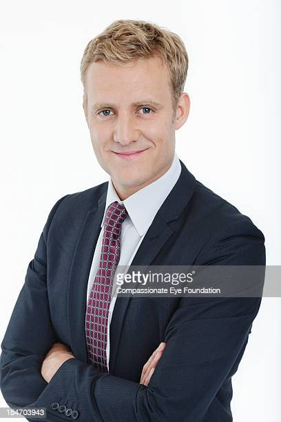 "portrait of smiling businessman with arms folded - ""compassionate eye"" stock pictures, royalty-free photos & images"