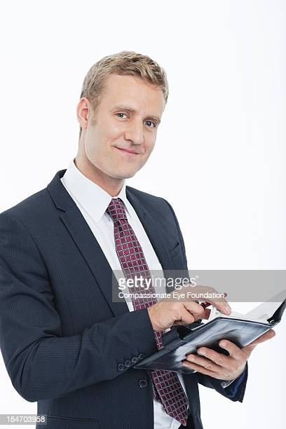 "portrait of smiling businessman with diary - ""compassionate eye"" stock pictures, royalty-free photos & images"
