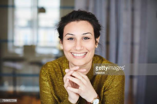 Portrait of smiling businesswoman at creative office