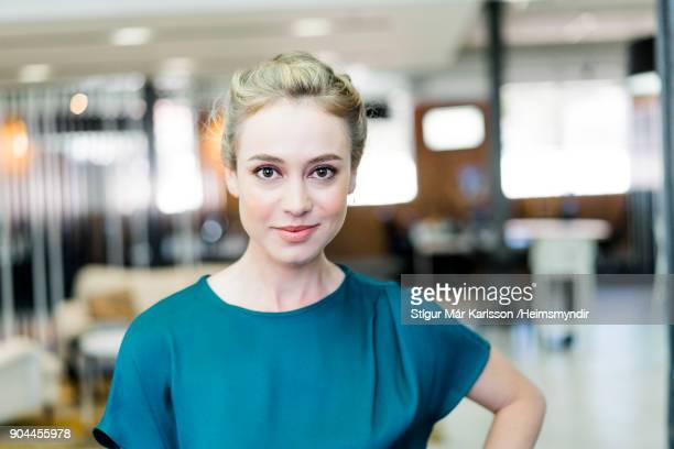 portrait of smiling businesswoman at office - 30 34 years stock pictures, royalty-free photos & images