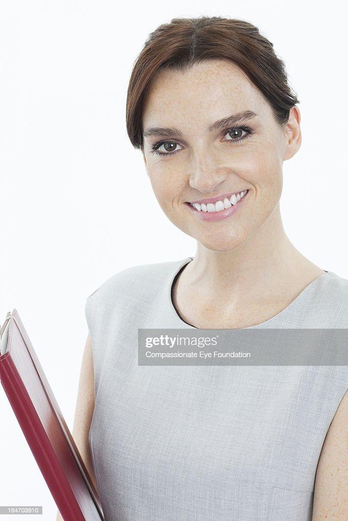 Portrait of smiling businesswoman, close up : Stock Photo