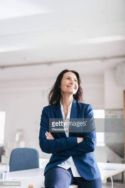 Portrait of smiling businesswoman in a loft