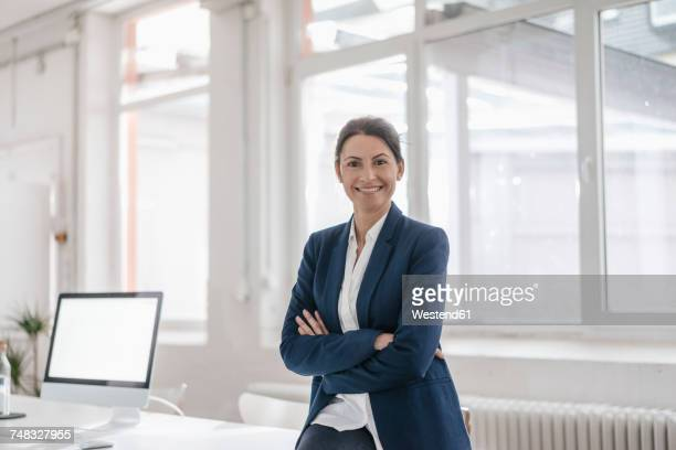 Portrait of smiling businesswoman in an office