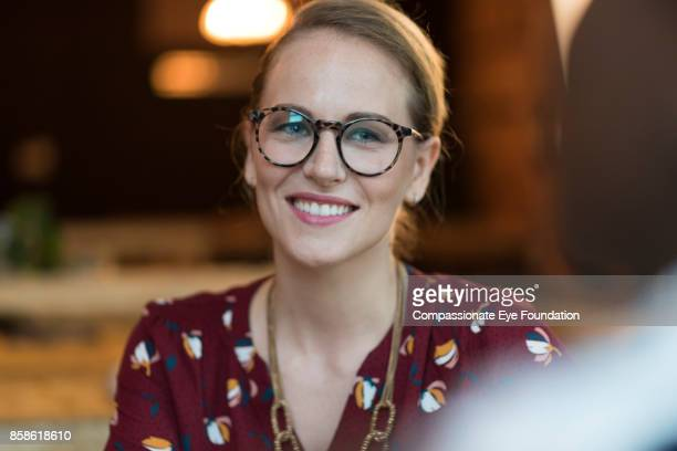 Portrait of smiling businesswoman in cafe