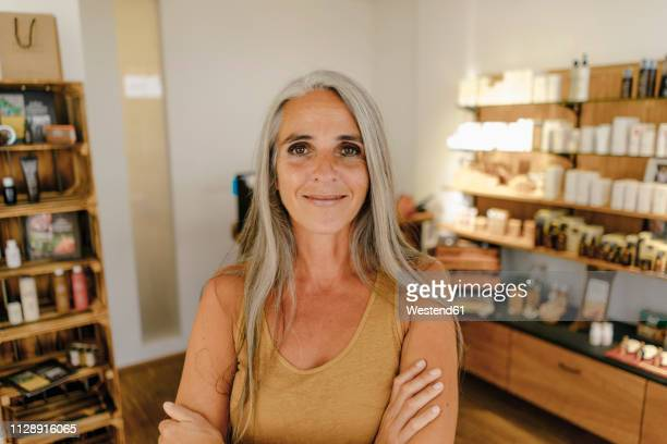 portrait of smiling businesswoman in her shop - employee appreciation stock pictures, royalty-free photos & images