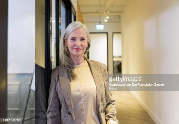 Portrait of smiling businesswoman in modern office