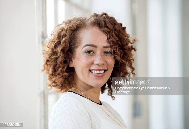 portrait of smiling businesswoman in modern office - vanguardians stock pictures, royalty-free photos & images