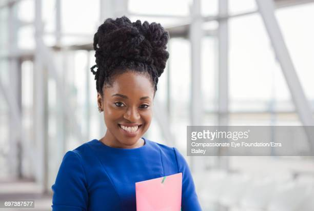 Portrait of smiling businesswoman in modern office