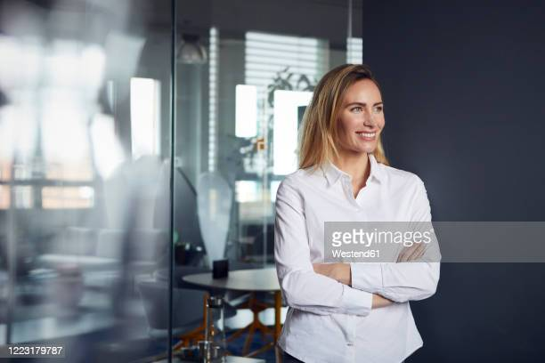 portrait of smiling businesswoman in office - blouse stock pictures, royalty-free photos & images