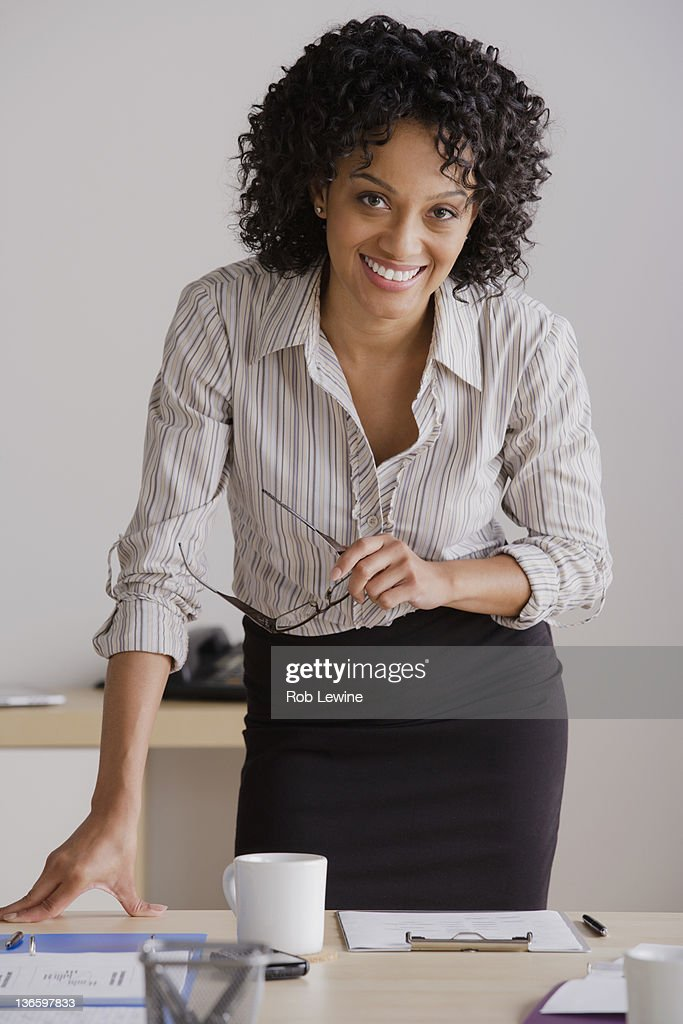 Portrait of smiling businesswoman in office : Stock Photo