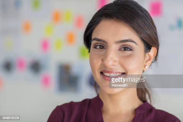 portrait of smiling businesswoman in office - mid adult stock pictures, royalty-free photos & images