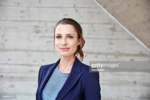 portrait of smiling businesswoman - saleswoman stock photos and pictures