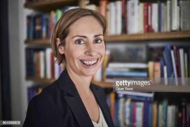 Portrait of smiling businesswoman wearing braces