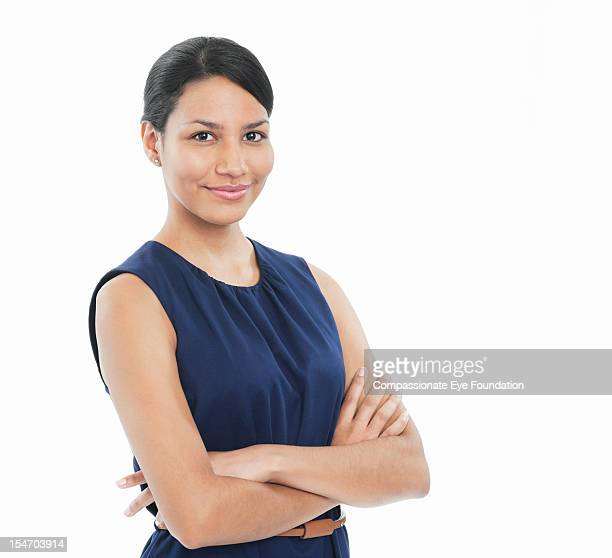 portrait of smiling businesswoman with arms folded - compassionate eye foundation stock pictures, royalty-free photos & images