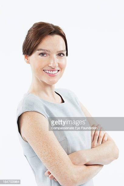 Portrait of smiling businesswoman with arms folded