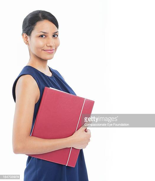 portrait of smiling businesswoman with folder - compassionate eye foundation stock pictures, royalty-free photos & images