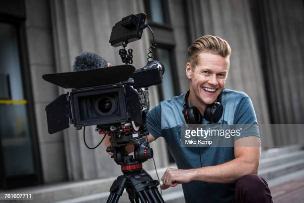 portrait of smiling camera operator - cinematographer stock pictures, royalty-free photos & images