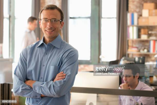Portrait of smiling Caucasian businessman in office