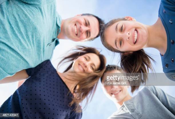 Portrait of smiling Caucasian family in huddle
