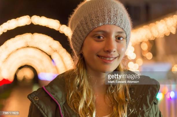 Portrait of smiling Caucasian girl on sidewalk