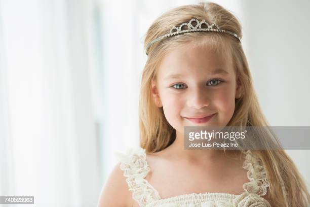 Portrait of smiling Caucasian girl wearing tiara