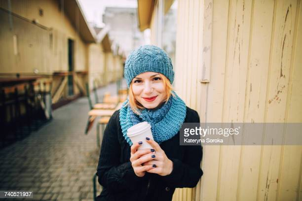 portrait of smiling caucasian woman holding coffee cup - odessa ukraine stock photos and pictures