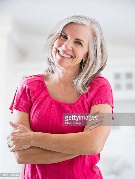 Portrait of smiling Caucasian woman with arms crossed