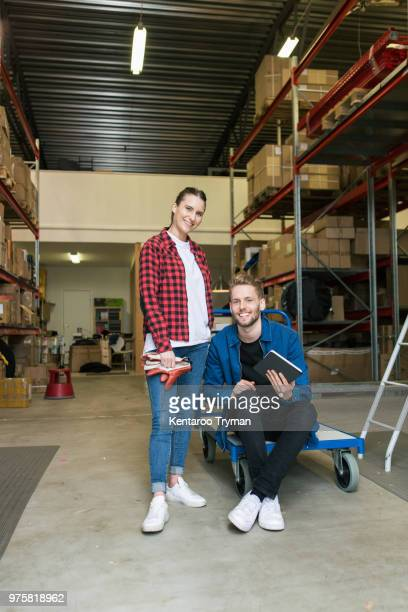 Portrait of smiling colleagues in distribution warehouse