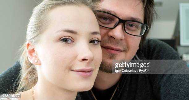 portrait of smiling couple at home - igor golovniov stock pictures, royalty-free photos & images
