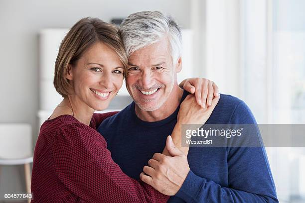 Portrait of smiling couple head to head