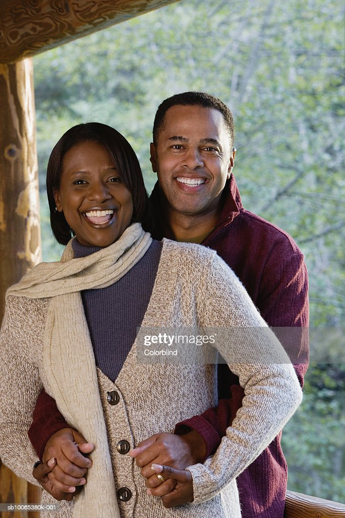Portrait of smiling couple on porch : Foto stock