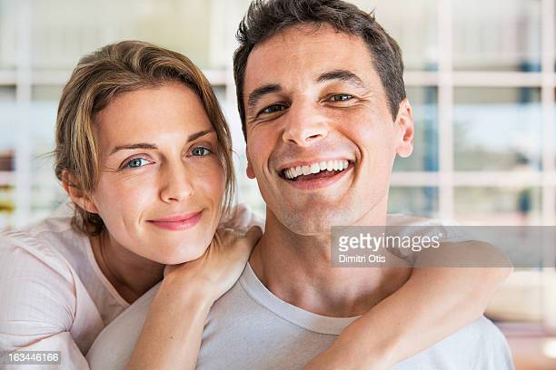 Portrait of smiling couple, outdoors