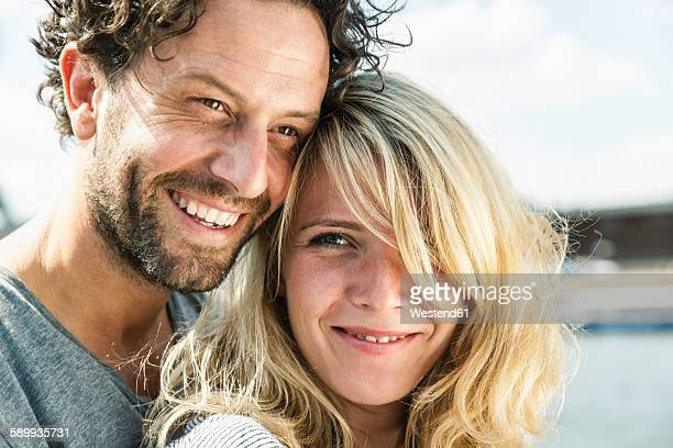 portrait of smiling couple outdoors - 35 39 years stock pictures, royalty-free photos & images