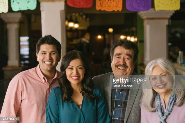 portrait of smiling couples in restaurant - mother in law stock pictures, royalty-free photos & images