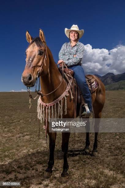 Portrait of Smiling Cowgirl on Horseback in Utah