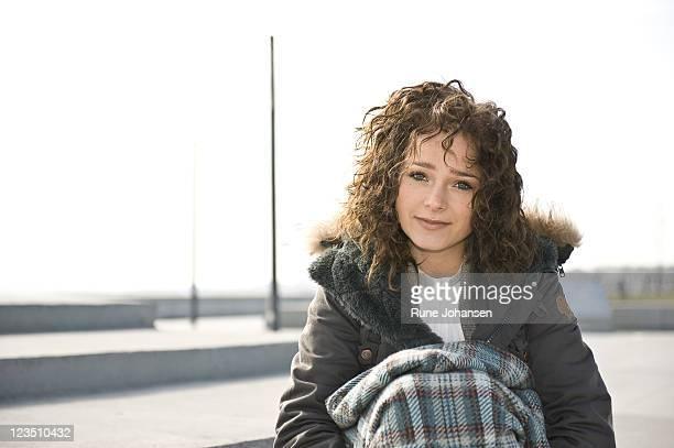 Portrait of smiling Danish woman, 26 years old, outdoors at Amager Strandpark, Copenhagen, Denmark
