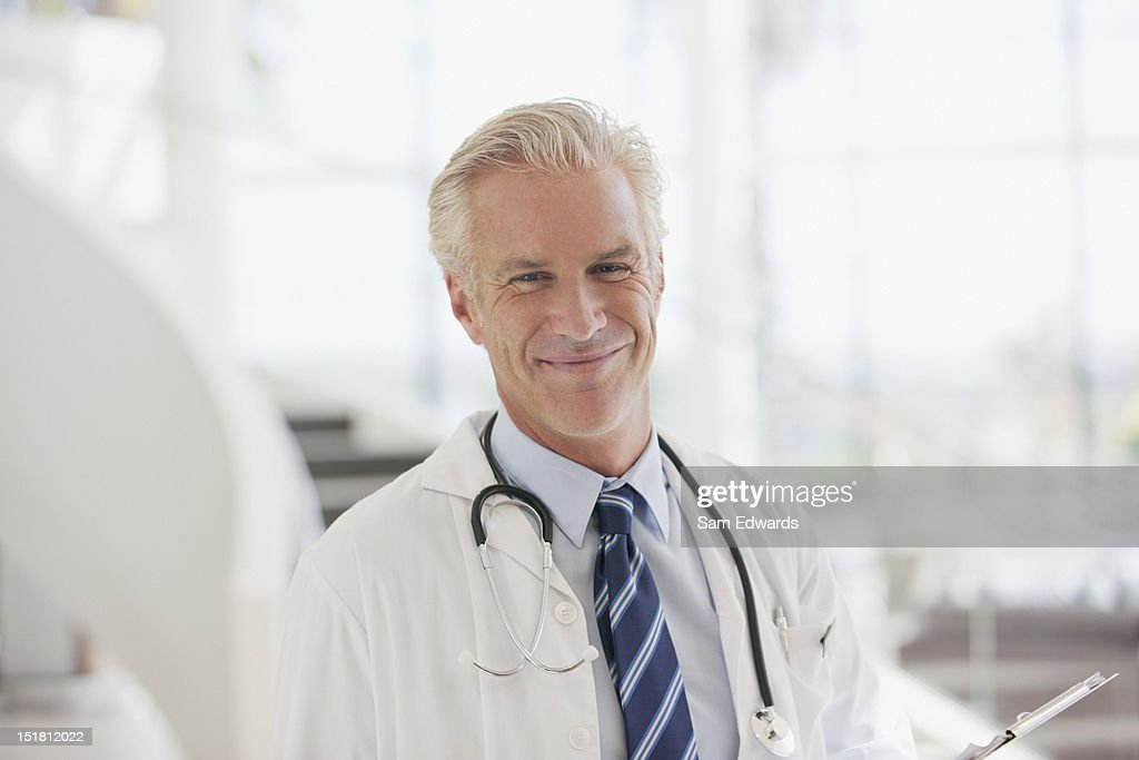 Portrait of smiling doctor in hospital : Stock Photo
