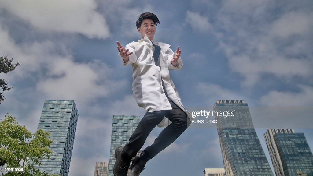 Portrait of smiling doctor jumping : Stock-Foto