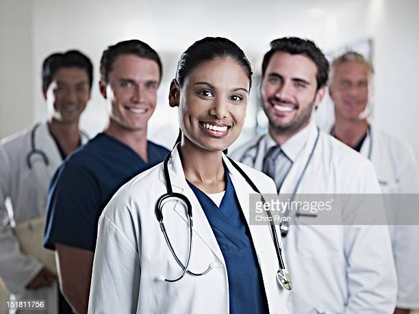 portrait of smiling doctors and nurse - group of doctors stock pictures, royalty-free photos & images