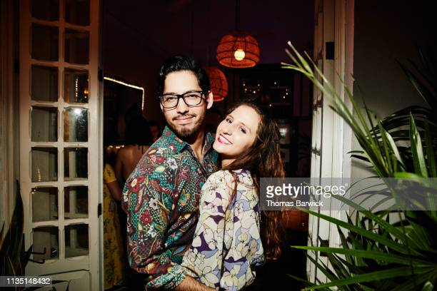 portrait of smiling embracing couple on date in night club - printed sleeve stock pictures, royalty-free photos & images