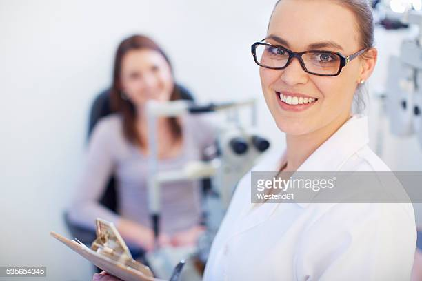 Portrait of smiling eye doctor