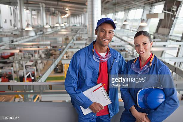 Portrait of smiling factory workers