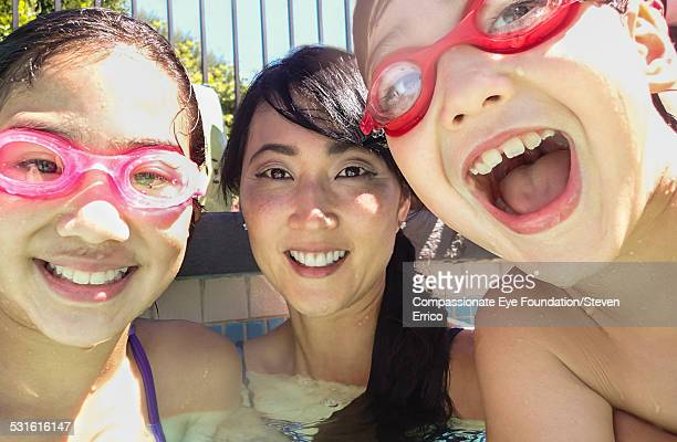 Portrait of smiling family in swimming pool