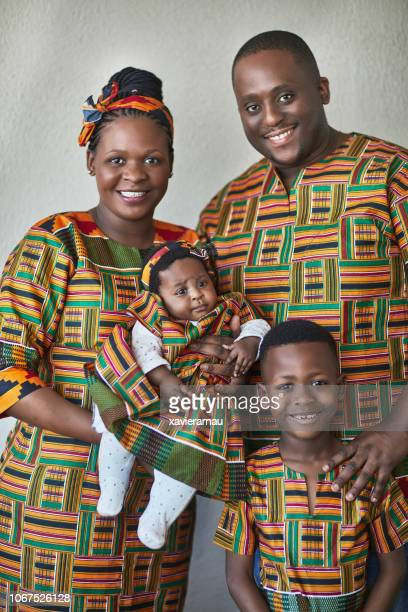 portrait of smiling family wearing dashiki - dashiki stock photos and pictures