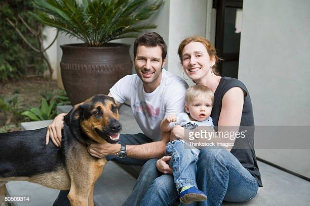 Portrait of smiling family with dog