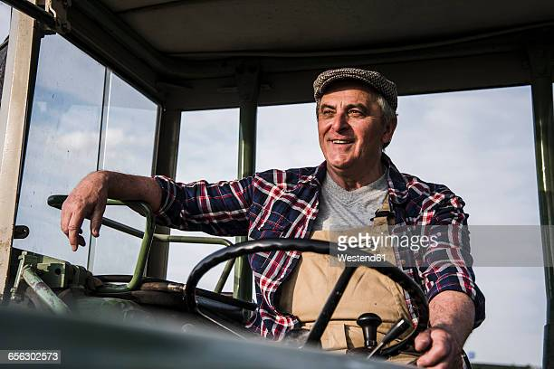 Portrait of smiling farmer on tractor