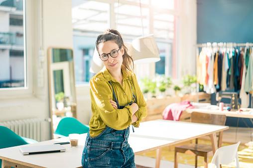 Portrait of smiling fashion designer in her studio - gettyimageskorea