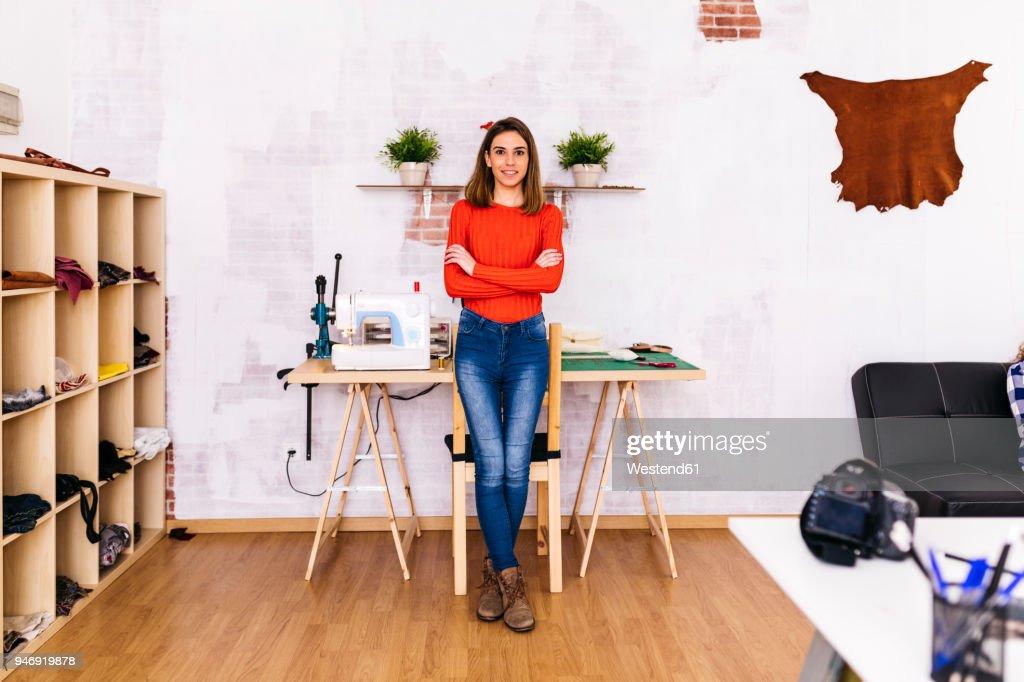 Portrait of smiling fashion designer in studio : Stock Photo
