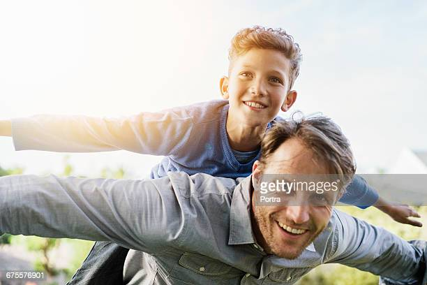 Portrait of smiling father playing with son