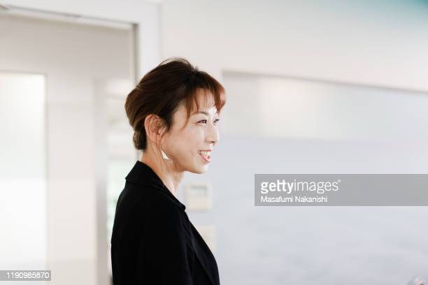 portrait of smiling female business woman - business ストックフォトと画像